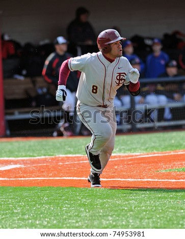COLLEGE PARK, MD - APRIL 2: Florida State University second baseman Devon Travis sprints to first base after making contact during a game against Maryland April 2, 2011 in College Park, MD.