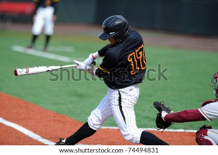 COLLEGE PARK, MD - APRIL 2: University of Maryland baseball outfielder Charlie White swings at a pitch early in a game April 2, 2011 in College Park, MD