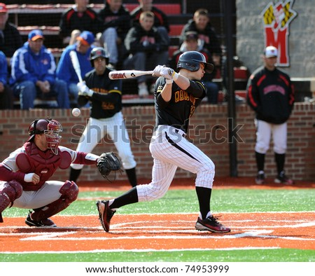 COLLEGE PARK, MD - APRIL 2: University of Maryland catcher Alex Ramsay (center) fouls off a pitch during a game against #7 Florida State April 2, 2011 in College Park, MD.
