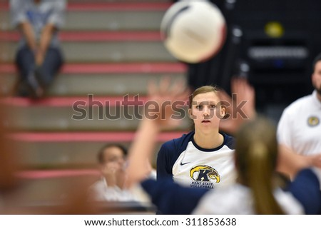 COLLEGE PARK, MD - AUGUST 28: A Kent State player watches a set intently during warm-ups prior to the NCAA women's volleyball game August 28, 2015 in College Park, MD.  - stock photo