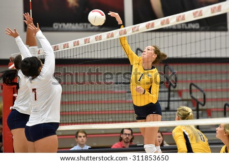 COLLEGE PARK, MD - AUGUST 28: Kent State middle blocker Darby Connors (1) goes up for a spike during the NCAA women's volleyball game August 28, 2015 in College Park, MD.  - stock photo