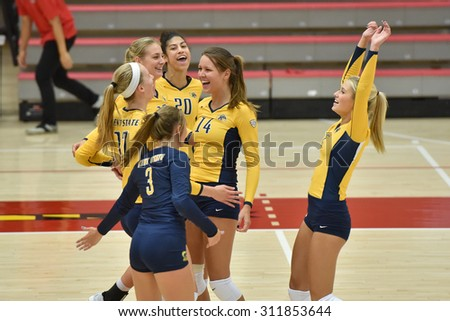 COLLEGE PARK, MD - AUGUST 28: Kent State volleyball players celebrate winning a tough point during the NCAA women's volleyball game August 28, 2015 in College Park, MD.  - stock photo