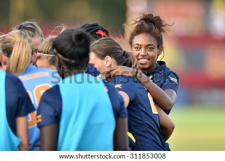 COLLEGE PARK, MD - AUGUST 28: West Virginia's Nia Gordon (99) shown in the pregame huddle prior to the NCAA women's soccer game August 28, 2015 in College Park, MD.  - stock photo