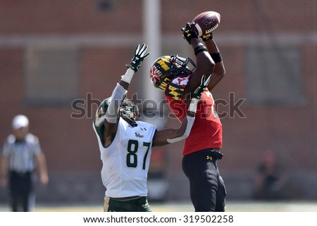 COLLEGE PARK, MD - SEPTEMBER 19: Maryland Terrapins defensive back Sean Davis (21) goes up an makes an interception during a NCAA football game September 19, 2015 in College Park, MD.  - stock photo