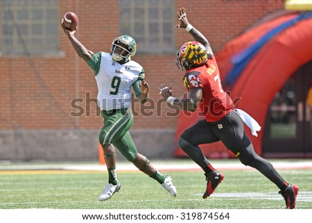 COLLEGE PARK, MD - SEPTEMBER 19: South Florida Bulls quarterback Quinton Flowers (9) throws on the run during a NCAA football game September 19, 2015 in College Park, MD.  - stock photo