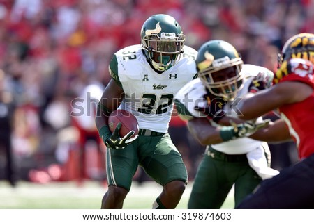COLLEGE PARK, MD - SEPTEMBER 19: South Florida Bulls running back D'Ernest Johnson (32) runs behind his blocker during a NCAA football game September 19, 2015 in College Park, MD.