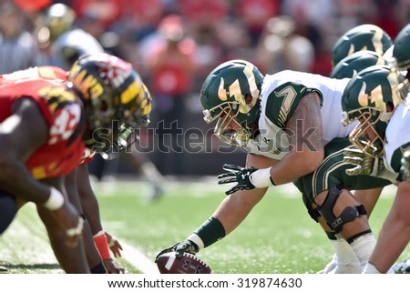 COLLEGE PARK, MD - SEPTEMBER 19: The USF and Maryland football teams line-up prior to a snap during a NCAA football game September 19, 2015 in College Park, MD.  - stock photo