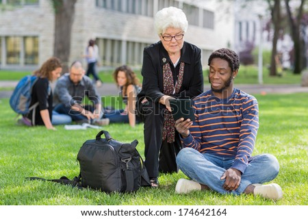 College professor helping grad student with question - stock photo