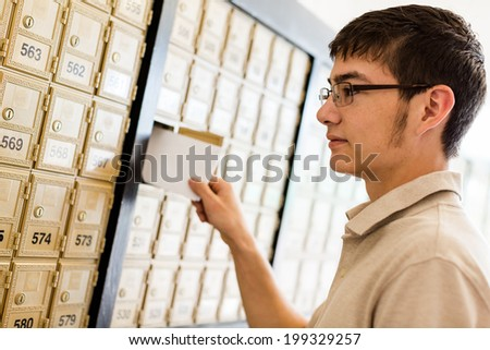 College student checking mail at mailboxed.