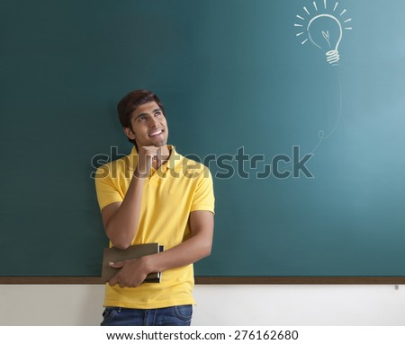 College student getting an idea - stock photo
