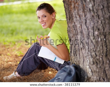 college student looking back and smiling. Copy space