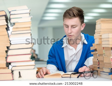 College student on university campus desk reading for research