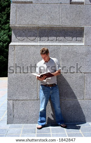 College student reading outside building - stock photo