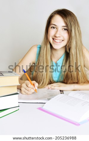 College student studying. Studying cheerful  teenager girl. - stock photo