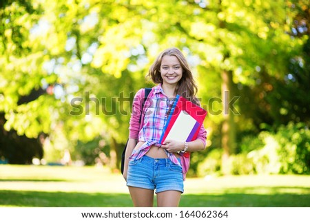 College student with books and folders