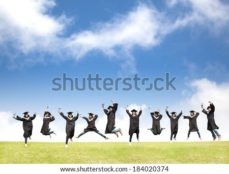 College students celebrate graduation and happy jump - stock photo