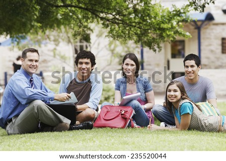 College Students Enjoying Class Outside on a Nice Day - stock photo