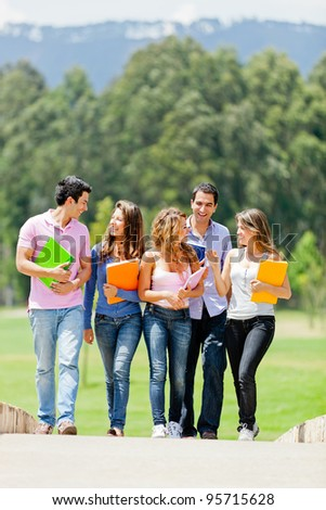 College students hanging around talking and smiling - stock photo