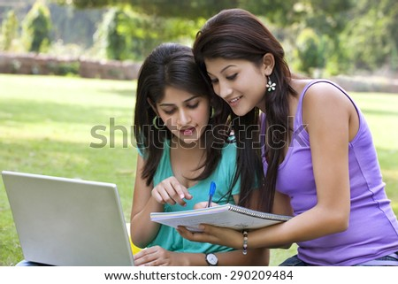 College students taking notes from laptop - stock photo