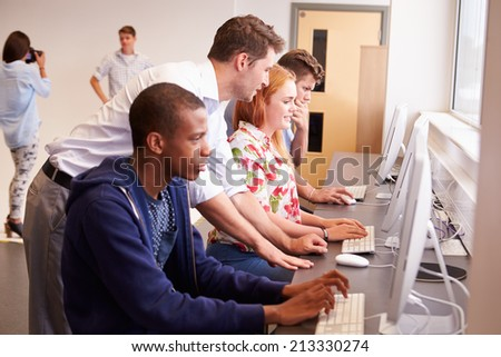 College Students Using Computers On Media Studies Course - stock photo