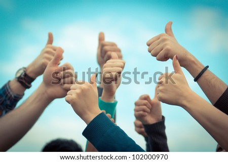 College Students with Thumbs Up - stock photo
