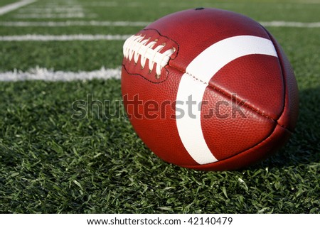 Collegiate Football near the yard lines - stock photo