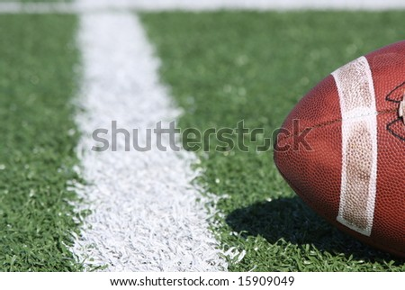 Collegiate football near the yardline - stock photo