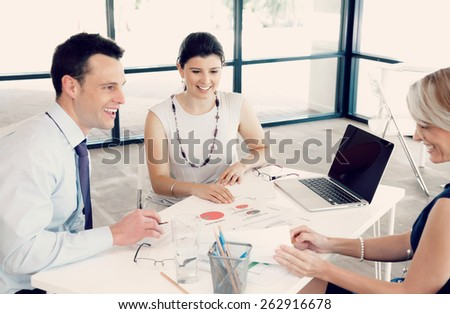 Collegues having a discussion in office - stock photo