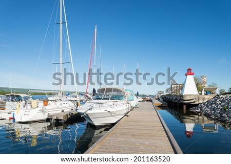 Collingwood Harbor with lighthouse and boats - stock photo