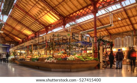 COLMAR,FRANCE- DEC 06: People shopping in the vegetables market in Colmar, Alsace, France on December 6,2013.