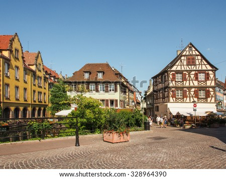 COLMAR, FRANCE - JULY 27 2013: Colmar's architectural landmarks reflect 8 centuries of Germanic and French architecture and the adaptation of their respective stylistic language to the local customs.