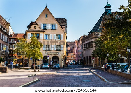 COLMAR, FRANCE - JUNE 14, 2017: Colorful traditional french houses and shops in Colmar, Alsace, France