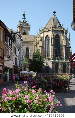 COLMAR, FRANCE - SEPTEMBER 14: The cathedral from the street Rue de Eglise in the city Colmar in France on September 14, 2016.