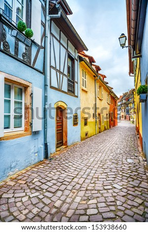 Colmar, Petit Venice, narrow street and traditional half timbered colorful houses. Alsace, France. - stock photo