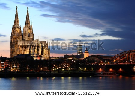 Cologne cathedral across the Rhine river - stock photo