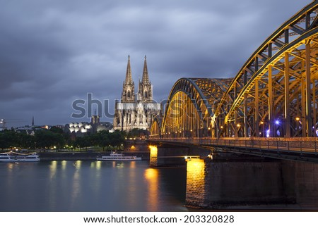 Cologne Cathedral and Hohenzollern Bridge in evening. Cologne, North Rhine - Westphalia, Germany - stock photo
