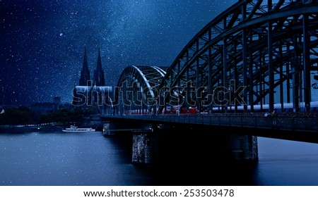 Cologne Cathedral and Hohenzollern Bridge on the background of the star sky   - stock photo