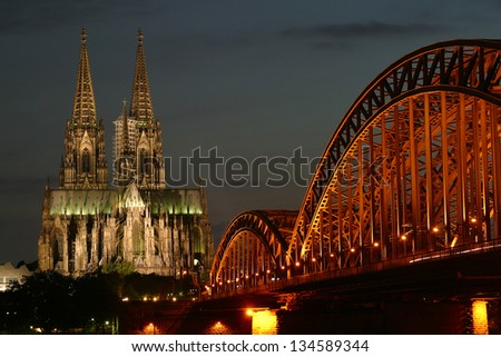 Cologne Cathedral and Train Bridge at night - stock photo