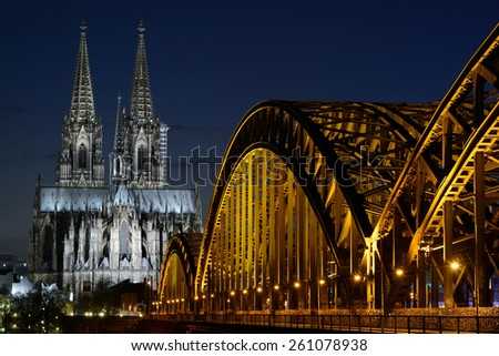 Cologne Cathedral (Dom) and Hohenzollern Bridge, Cologne, Germany - stock photo