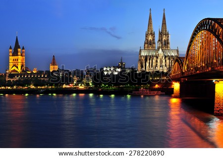 Cologne Cathedral, Germany, 18. July 2014- Cityscape of Cologne from the Rhine river at night time with Cologne Cathedral and Hohenzollern Bridge.