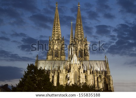 Cologne Cathedral in Germany illuminated against a late evening sky - stock photo