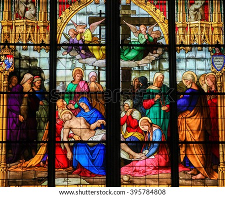 COLOGNE, GERMANY - APRIL 21, 2010: Mourning window in Dom of Cologne, Germany. This stained glass depicts the mourning of the dead Christ.