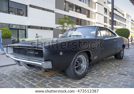 COLOGNE, GERMANY - AUG 7, 2016: Black Dodge Charger muscle car from ca. 1970  at an exhibition in the city of Cologne, Germany