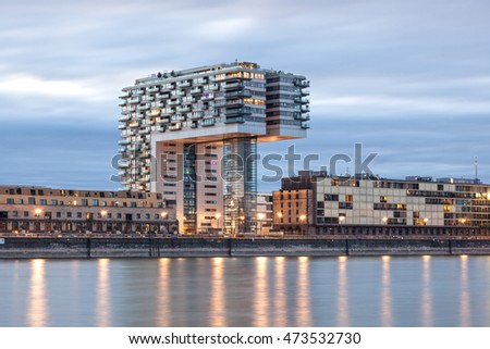 COLOGNE, GERMANY - AUG 7, 2016: Crane House at the Rhine river in Cologne illuminated at night. North Rhine-Westphalia, Germany