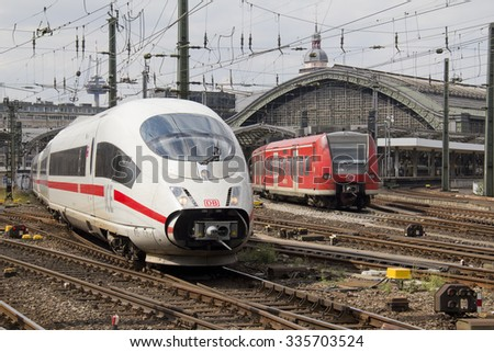 Cologne, Germany - August 27, 2013: International and regional trains enter and leave Cologne main railway station  on August 27, 2013 in Cologne, Germany - stock photo