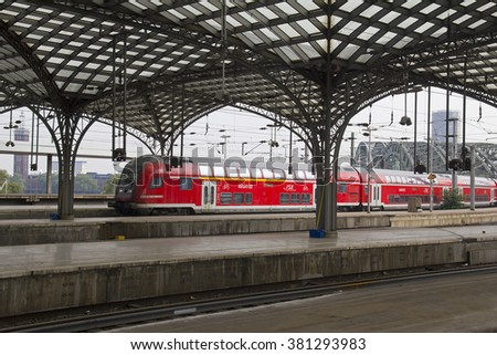 Cologne, Germany - August 30, 2013: Local German train arrives in the historic railway station of Cologne, Germany on August 30, 2013