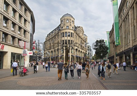 Cologne, Germany - August 27, 2013: People shopping in the Schildergasse street in Cologne on August 27, 2013 in Cologne, Germany