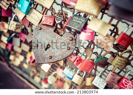 COLOGNE, GERMANY - AUGUST 26, 2014, Thousands of love locks which sweethearts lock to the Hohenzollern Bridge to symbolize their love on August 26 in Koln, Germany  - stock photo