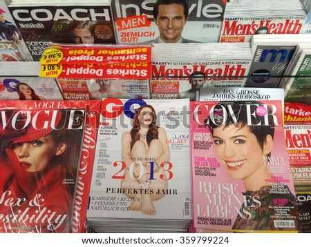 Cologne,Germany- December 17,2012: Popular fashion magazines in german language on display in a store  in Cologne,Germany  - stock photo