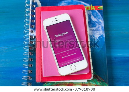 Cologne, Germany- February 21, 2016: Iphone 5 White with opened Instagram application in german language on the table. - stock photo